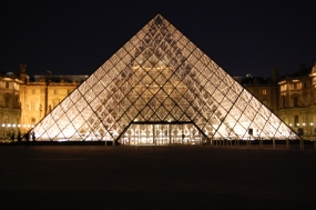 Outside the Louvre at night