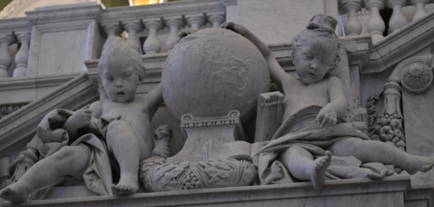 Two cherub-esque figures on the staircase from the Library of Congress lobby