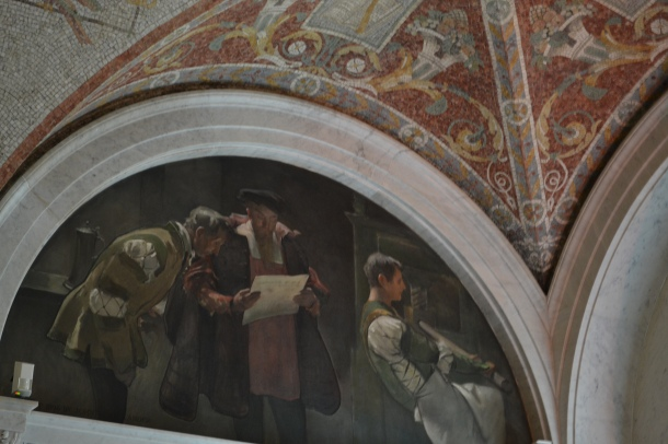 A mural of Gutenberg above one of the few perfect copies of the Gutenberg Bible, which is not allowed to be photographed