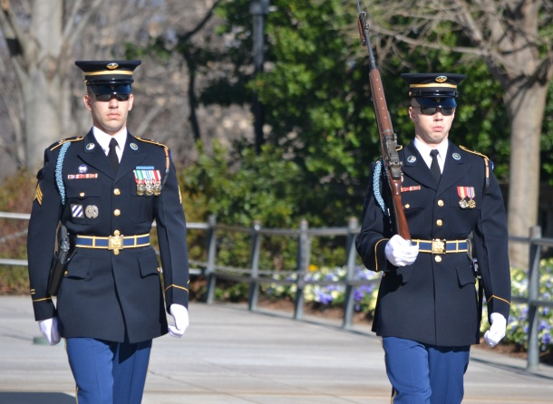 The sergeant and the current guard walking