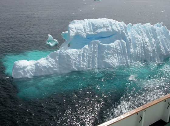 An alligator-like glowing iceberg