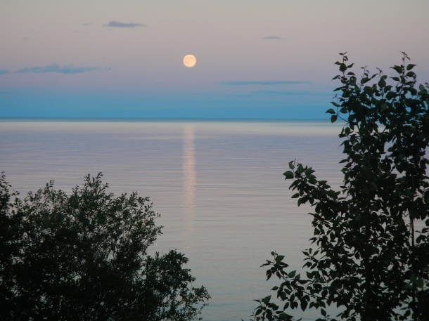 The moon rising over Lake Superior