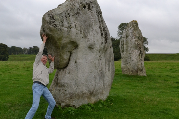 Avebury Stone Circle England Dad holding up the rocks